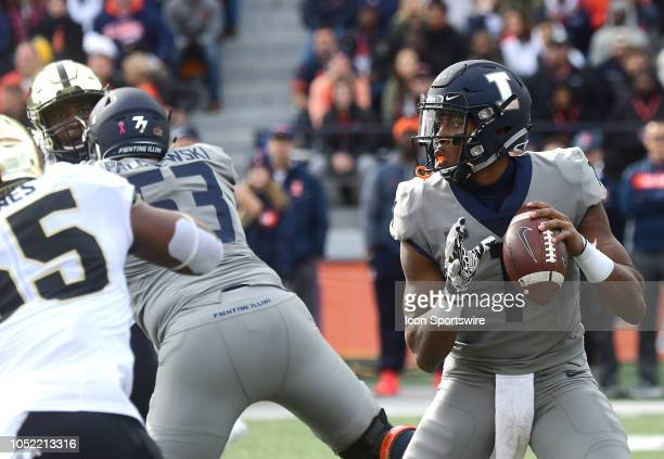 Illinois Fighting Illini quarterback AJ Bush sets up to pass during a Big Ten Conference college football game between the Purdue Boilermakers and...