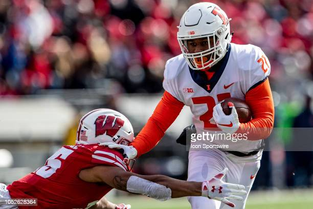Illinois Fighting Illini running back Ra'Von Bonner stiff arms Wisconsin Badgers safety Eric Burrell during an college football game between the...