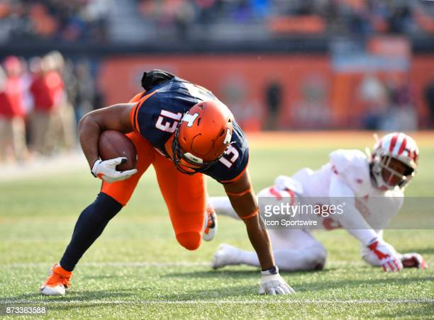 Illinois Fighting Illini tight end Caleb Reams breaks Indiana Hoosiers defensive back Tony Fields tackle and keeps his balance to score a touchdown...