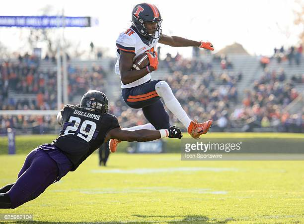 Illinois Fighting Illini wide receiver Malik Turner hurdles Northwestern Wildcats defensive back Trae Williams to score a touchdown during the...