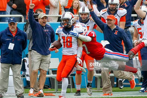 Illinois Fighting Illini wide receiver Mike Dudek is brought down by Louisiana Tech Bulldogs defensive back Xavier Woods after a long gain during the...