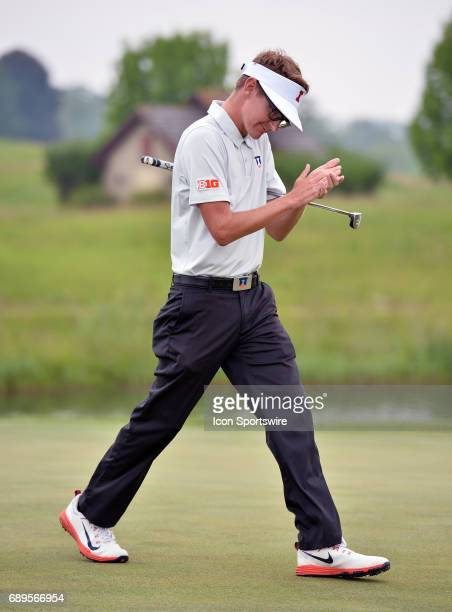 Illinois Fighting Illinis Dylan Meyer claps after scoring a birdie during round 3 of the Division I Men's Golf Championships on May 28 2017 at Rich...
