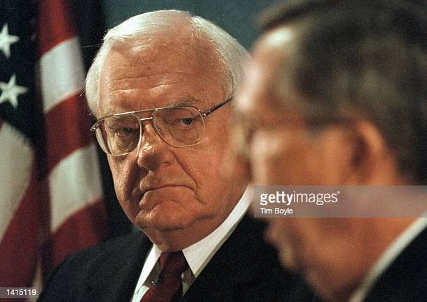 Illinois Gov George Ryan looks towards Illinois State Police Director Sam Nolen right as he addresses the media April 20 2000 at a news conference at...
