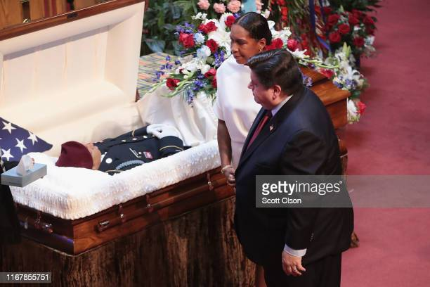 Illinois Gov JB Pritzker and Lt Gov Juliana Stratton view the remains of US Army Spc Michael Nance during a visitation at Trinity United Church of...