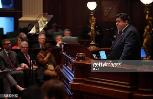 Illinois Gov JB Pritzker delivers his first budget address to a joint session of the Illinois House and Senate at the Illinois State Capitol on...