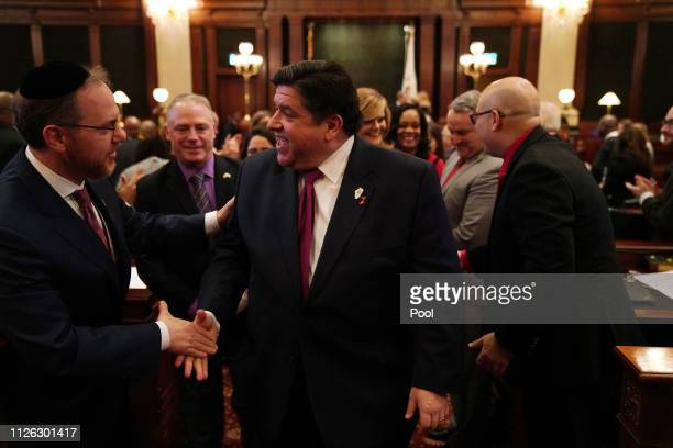 Illinois Gov JB Pritzker is congratulated by lawmakers after delivering his first budget address to a joint session of the llinois House and Senate...