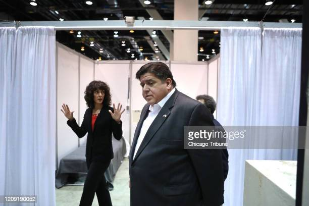 Illinois Gov JB Pritzker tours Hall C of the COVID19 field hospital at McCormick Place on April 3 2020 in Chicago In the background is Christina...