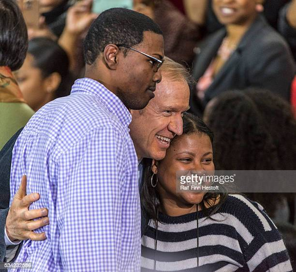 Illinois Governor Bruce Rauner poses for photos before President Barack Obama speaks to a crowd at Gwendolyn Brooks College Prep on the South Side of...