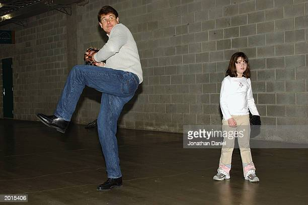 Illinois governor Rod Blagojevich and his daughter Amy play catch with friends in the service tunnel of US Cellular Field during a rain delay before...