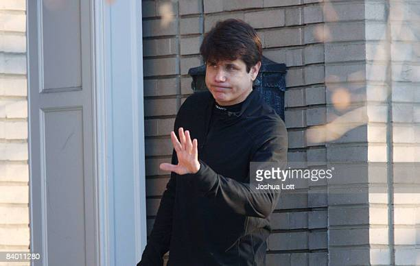 Illinois Governor Rod Blagojevich waves at the media from his front porch outside of his home December 12 2008 in Chicago Illinois Blagojevich was...
