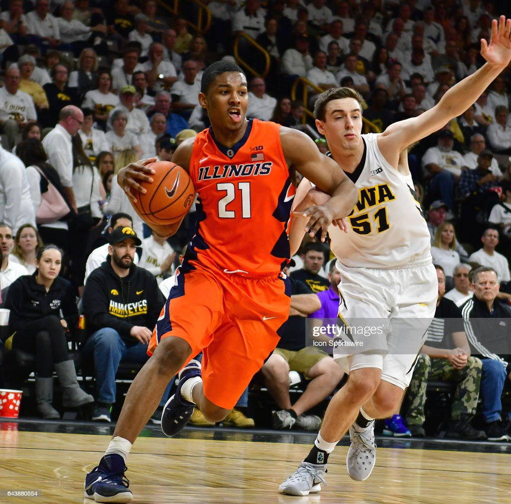 Illinois guard Malcolm Hill (21) gets by Iowa Hawkeyes' forward Nicholas Baer (51) during a Big Ten Conference basketball game between the University of Illinois Fighting Illini and the University of Iowa Hawkeyes on February 18, 2017, at Carver-Hawkeye Arena in Iowa City, IA.