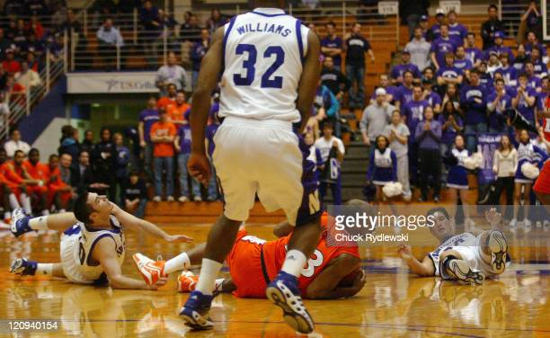 Illinois Guard Rich McBride hits the floor with two Northwestern players during their game against the Northwestern Wildcats February 7 2007 at...