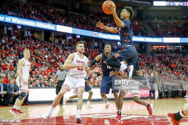 Illinois guard Trent Frazier flies to the basket past Wisconsin forward Alex Illikainen during a college basketball game between the University of...