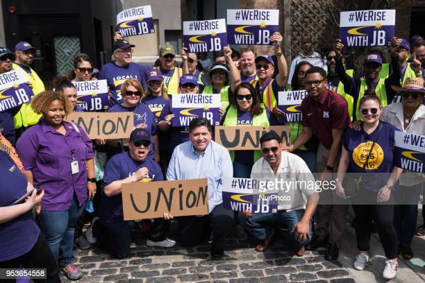 Illinois gubernatorial candidate JB Pritzker poses for a photo with union members on May Day also known as International Workers Day in Chicago on...