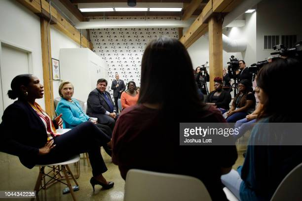 Illinois gubernatorial Lieutenant Governor candidate Juliana Stratton speaks with high school students during a round table discussion as former...