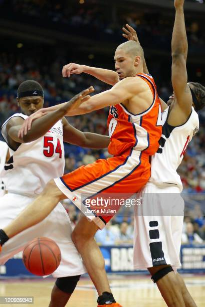 Illinois' James Augustine battles for a rebound during the first half of Illinois' 92-68 win against Cincinnati in the second round of the NCAA...