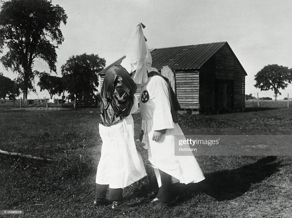 Ku Klux Klan Initiation Ceremonies  Photo shows a Klansman