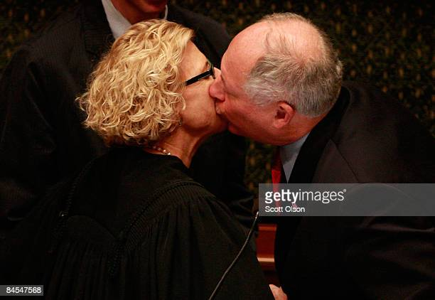 Illinois Lt Governor Pat Quinn gives a kiss to Justice Anne Burke after he was sworn in as Governor following Governor Rod Blagojevich's removal from...