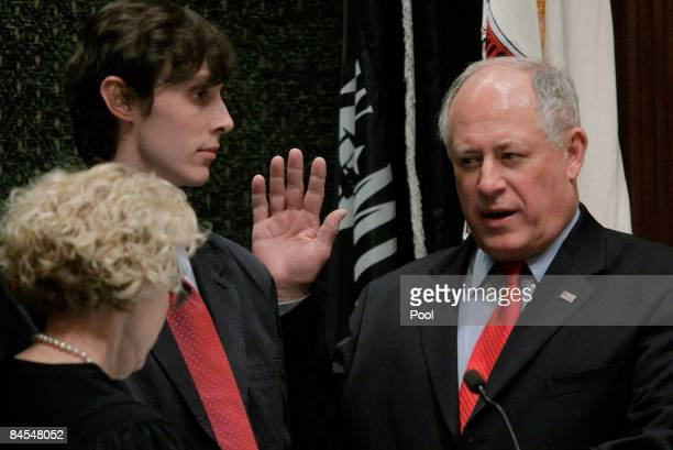 Illinois Lt Governor Pat Quinn is sworn in as Governor by Justice Anne Burke as his son Patrick holds the bible following Governor Rod Blagojevich's...