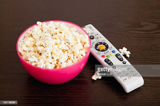 USA, Illinois, Metamora, Bowl of popcorn and remote control on table