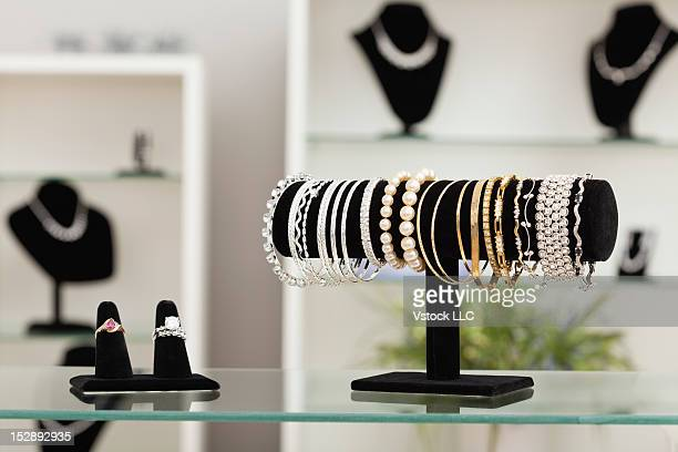 usa, illinois, metamora, bracelets and rings on display in jewelry store - jewelry store stock pictures, royalty-free photos & images
