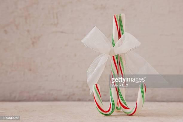 USA, Illinois, Metamora, Candy cane with white ribbon