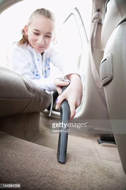 USA, Illinois, Metamora, Close-up of girls (12-13) hand cleaning car interior