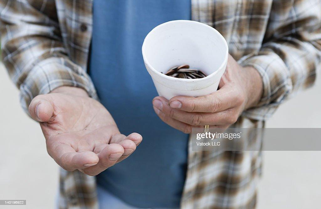 USA, Illinois, Metamora, Close-up of man begging for money : Stock Photo