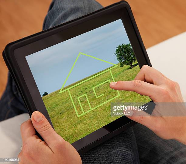 USA, Illinois, Metamora, Close-up of woman drawing house on digital tablet