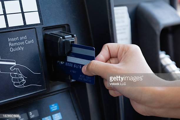 USA, Illinois, Metamora, close-up of woman paying by Credit Card