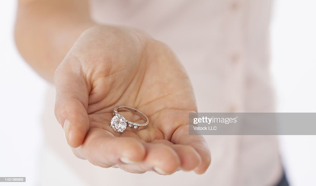 USA, Illinois, Metamora, Close Up Of Womanu0027s Hand Holding Engagement Ring