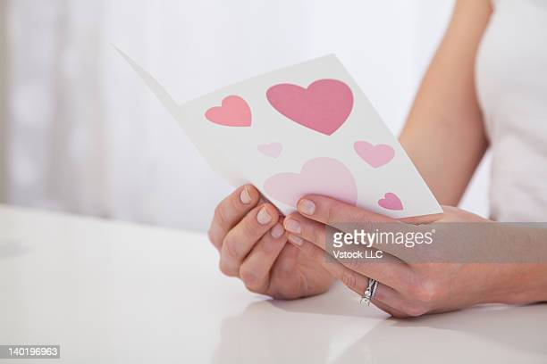 USA, Illinois, Metamora, Close-up of woman's hands holding Valentine's card