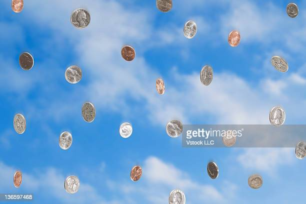 USA, Illinois, Metamora, Coins falling from sky