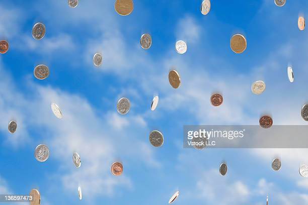 USA, Illinois, Metamora, Coins falling from sky