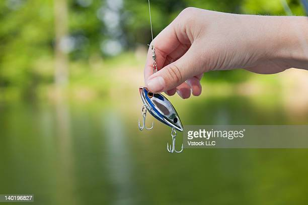 usa, illinois, metamora, girl's (10-11) hand holding fishing hook - 10 11 years stock photos and pictures