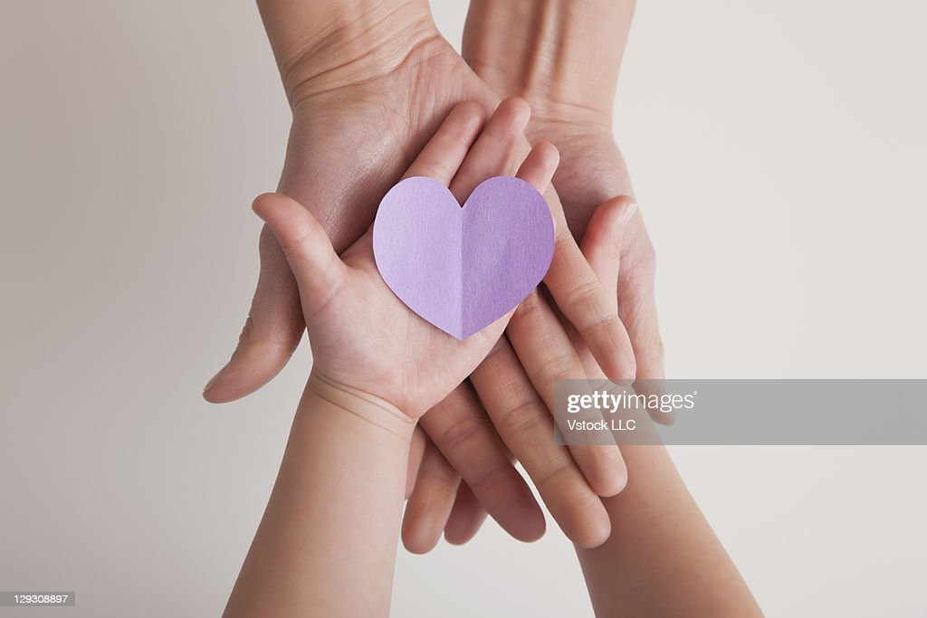 USA, Illinois, Metamora, Hands of mother and daughter (4-5) holding paper heart : Stock Photo