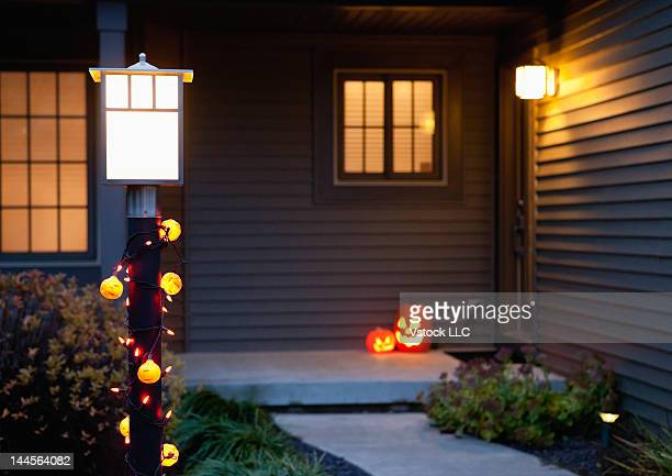 USA, Illinois, Metamora, Jack o' lanterns on porch