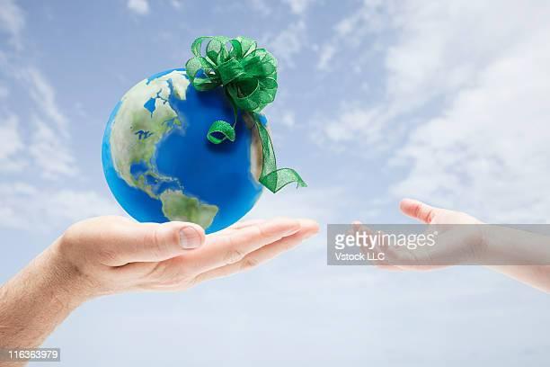 USA, Illinois, Metamora, Man giving globe to girl (4-5)