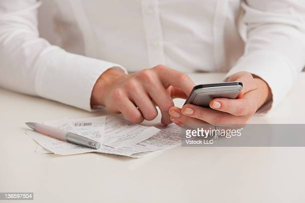USA, Illinois, Metamora, Midsection of woman using cell phone