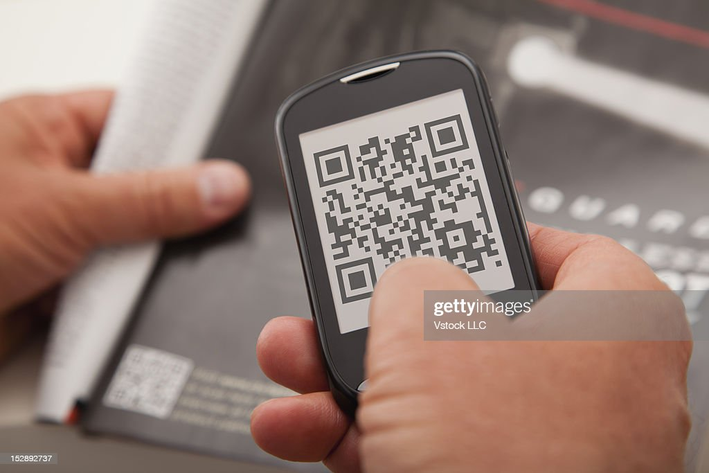 USA, Illinois, Metamora, Mobile phone with bar code in screen : Photo