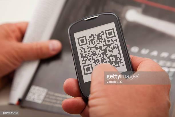 USA, Illinois, Metamora, Mobile phone with bar code in screen
