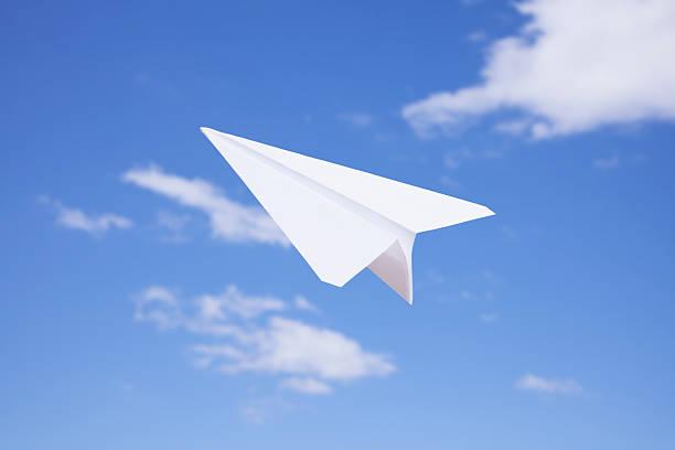 USA, Illinois, Metamora, Paper Airplane Flying Against Sky Wall Art