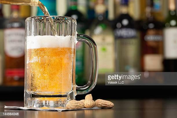 USA, Illinois, Metamora, Pouring lager beer into beer mug