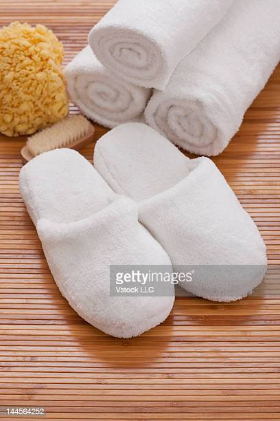 USA, Illinois, Metamora, Slippers and towels on mat