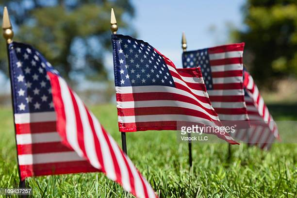 USA, Illinois, Metamora, Stars and Stripes flags in cemetery