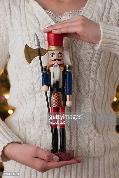 usa, illinois, metamora, teenage girl holding traditional nut cracker - halberd stock pictures, royalty-free photos & images