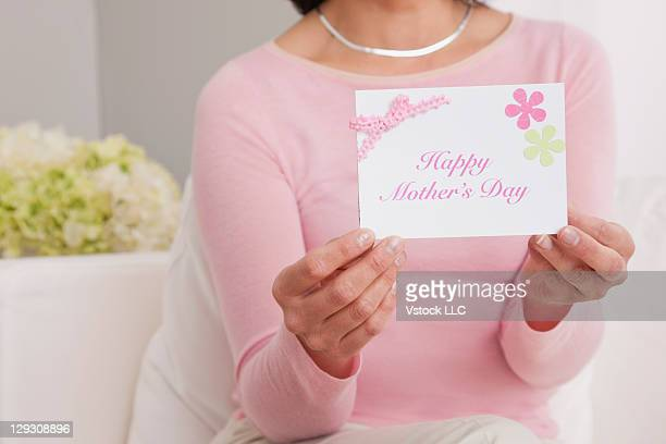 usa, illinois, metamora,woman showing happy mother's day card - mothers day card stock pictures, royalty-free photos & images