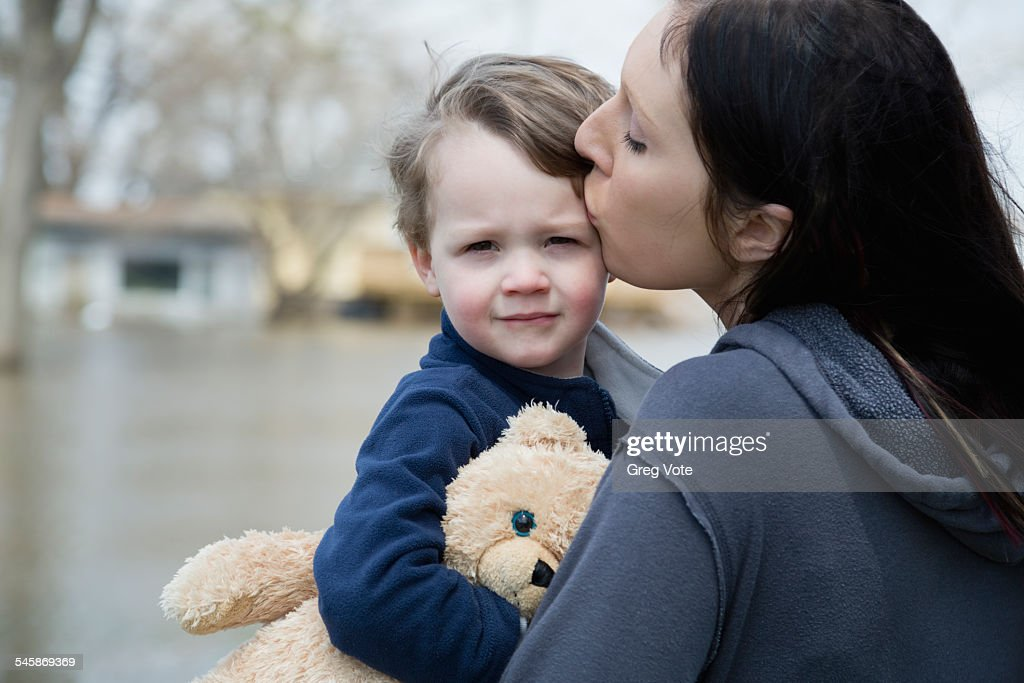 USA, Illinois, Mother with son standing in flooded town : Stock Photo