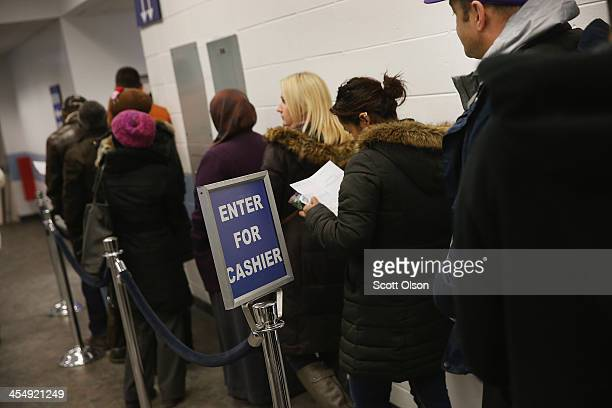 Illinois residents wait in line at a driver services facility on December 10 2013 in Chicago Illinois Illinois recently began a Temporary Visitors...