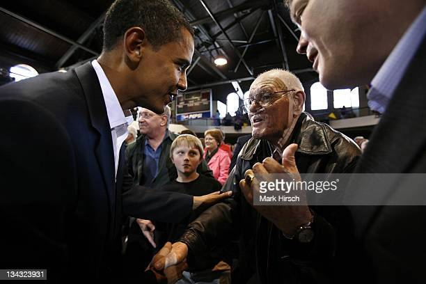 Illinois Senator and Democratic Presidential candidate Barack Obama talks with Edward Gaulrapp of Freeport Il during a campaign stop at the Loras...